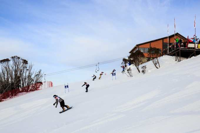 Snowboarders hitting the Supertrail after the big Kareela turn.