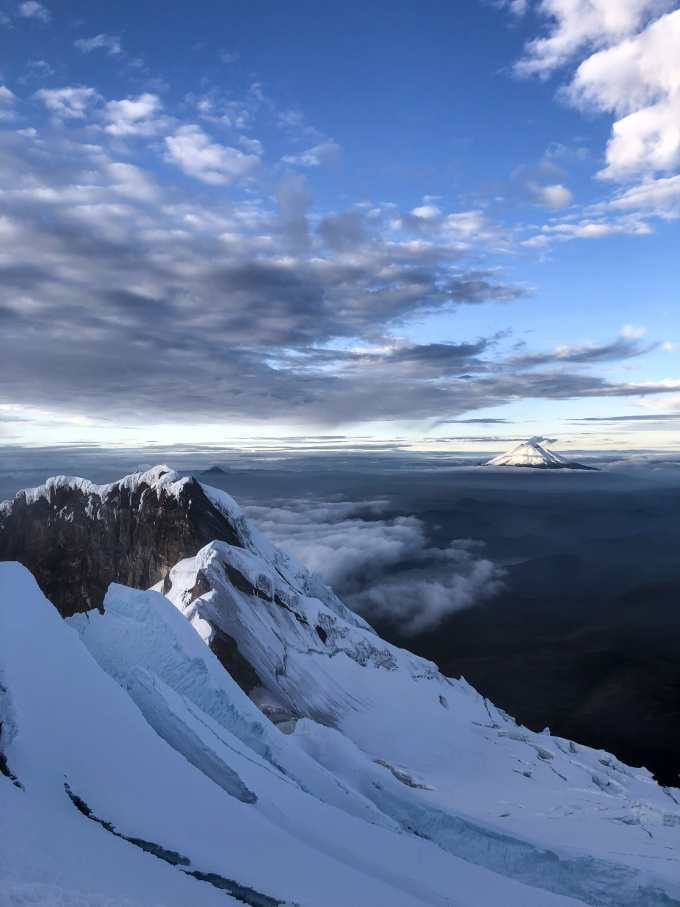 View from the summit of Anitsana. Cotopaxi in the background is active, you can tell by the plume emanating from the summit. Photo: Lucas