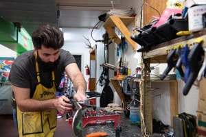 Anton carefully tuning his skis at home in the Pension Grimus Ski Centre, Mt Buller. Photo: Tony Harrington